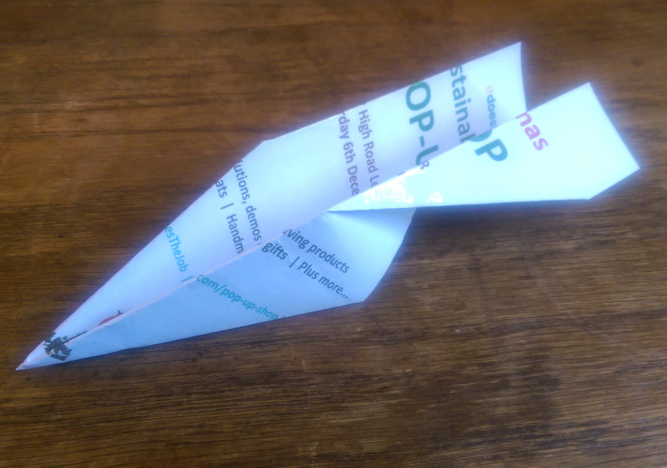 sustainable pop-up shop leaflet into paper areoplane